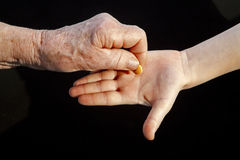 Hand of grandmother an grandchild and pill Royalty Free Stock Photography