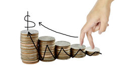 Hand and graph on money growth concept in business, Coins on whi Royalty Free Stock Photography