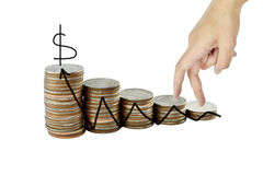 Hand and graph on money growth concept in business, Coins on whi Stock Photo