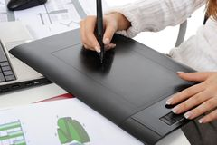Hand on graphic tablet. Stock Photos