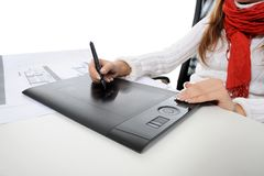 Hand on graphic tablet. royalty free stock photo
