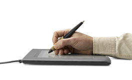 Hand on graphic tablet. Royalty Free Stock Image