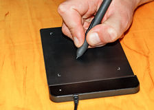 Hand on graphic tablet Stock Image