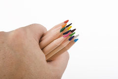 Hand grasping coloring pencils Royalty Free Stock Image