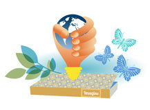 Hand grasping globe over book. With butterflies emerging and foliage Stock Photos