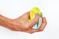 Hand grasps the paper trash on white background Royalty Free Stock Photos