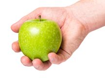 Hand with green apple. Male hand holding green apple, isolated on white background Royalty Free Stock Photo