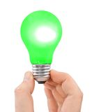 Hand with green bulb Stock Images