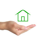 Hand with Green Cabin. Hand underneath illustration of green cabin with white studio background royalty free stock images