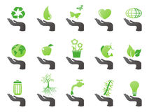 Hand with green eco icons. Isolated hand with green eco icons from white background Stock Image