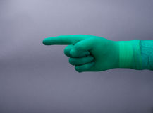Hand green glove and stethoscope. Hand surgery glove and stethoscope Stock Images