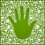 Hand with green icons background Stock Images