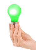 Hand with green lamp Stock Photos