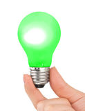 Hand with green lamp Royalty Free Stock Photography