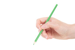 Hand with green pencil Stock Photos