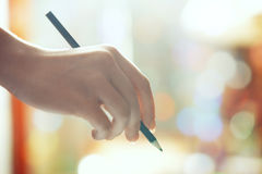Hand with green pencil Stock Photography