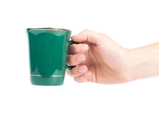Hand with green teacup isolated on a white Royalty Free Stock Photo