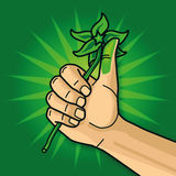 Hand with a green thumb Stock Photo