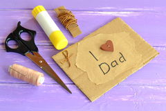 Hand greeting card with message I love dad. Scissors, glue, cord, thread, needle. Craft inspirations for kids. Homemade design fathers day card. Happy birthday stock photography