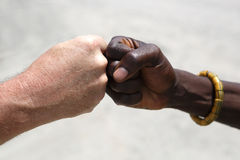 Hand greeting between a Caucasian and an African Stock Image