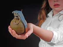 Hand Grenade in Child's Hand Stock Images