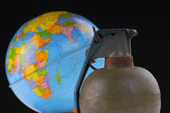 Hand Grenade and Globe Stock Images