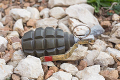 Hand grenade lying on the stones Royalty Free Stock Photography