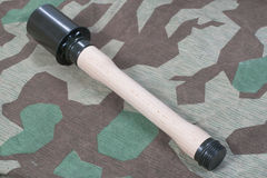 Hand grenade M24. On camouflaged background Royalty Free Stock Photography