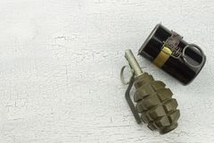 Hand grenade on shadowed, cracked background. War game. Sales of weapons royalty free stock image