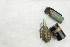 Hand grenade on shadowed, cracked background. War game. Sales of weapons royalty free stock photography
