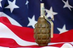 Hand grenade and and USA flag Royalty Free Stock Image