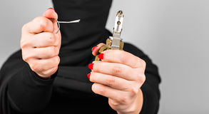 Hand grenade in a woman`s hand with the pin pulled Royalty Free Stock Photo