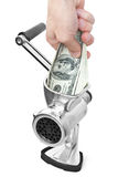 Hand and grinder with dollars. Money concept. Hand and dollars are milled in a meat grinder Stock Image