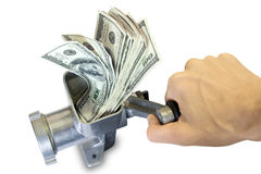Hand and grinder with dollars. Money concept. Hand and dollars are milled in a meat grinder Royalty Free Stock Photography