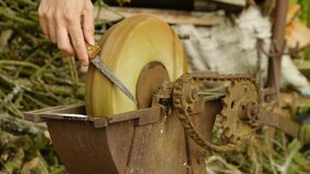 Hand grindstone - sharpening knives and tools stock video