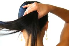 Hand Grip And Ponytail Stock Photography