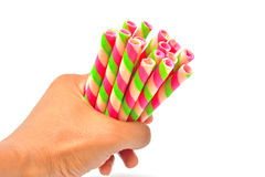 Hand grip colorful wafer roll isolated. On white background Stock Images