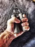 Hand grip exercise. Close view of hand,using hand grip exerciser Stock Photos