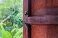 Hand grip at the old wooden door. Protect Anti-theft Protectio Stock Images