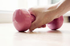Hand with grip on pink dumbbell Royalty Free Stock Images