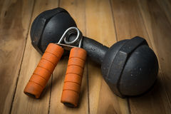 Hand Gripper and dumbbell Royalty Free Stock Photo