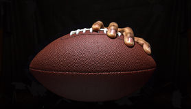 Hand Gripping Football Stock Image