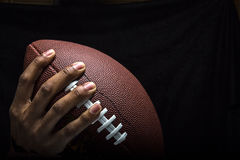 Hand Gripping Football to Pass Stock Images