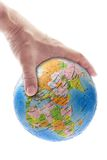 Hand gripping globe Royalty Free Stock Photo