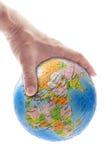 Hand gripping globe Royalty Free Stock Photo