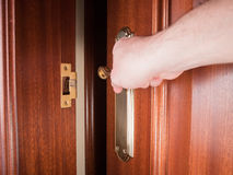 Hand gripping the handle of a door Royalty Free Stock Photos
