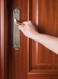 Hand gripping the handle of a door Royalty Free Stock Photography