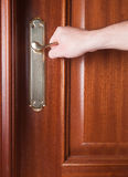 Hand gripping the handle of a door. Inside home Royalty Free Stock Photography