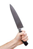 Hand gripping knife. A picture of a hand, holding a large kitchen knife Royalty Free Stock Image