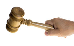 Hand gripping a wooden gavel Royalty Free Stock Images